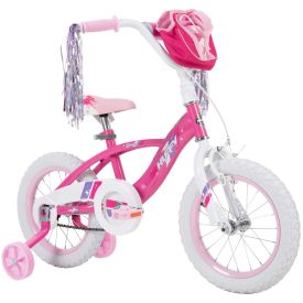 Girls bike with hot pink features and a handlebar bag