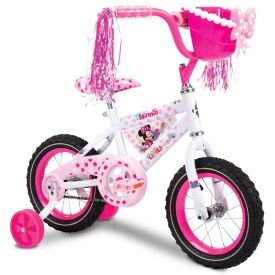 Minnie Mouse girls bike with lots of polka dots