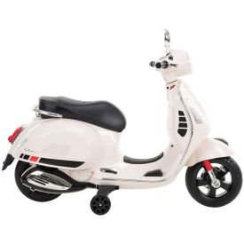 Profile view of the kids vespa ride on in white and black